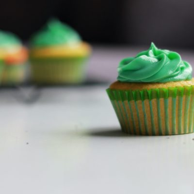 green cupcake selective photography